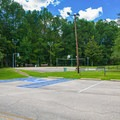 Basketball and volleyball court near park entrance.- Whitten Park