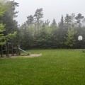 The playground and field in the campground.- Woodford State Park Campground