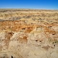 An aerial view of the badlands and horses.- Bisti/De-na-zin Badlands