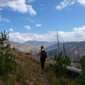At the saddle, hike down a bit further for a view of the Cache Creek Valley.- The Thunderer