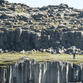 Tourists on the eastern bank.- Selfoss, Dettifoss, and Sanddalur