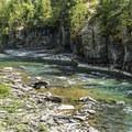 The creek has beautiful vertical walls in spots.- Upper McDonald Creek Trail