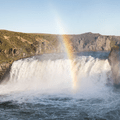 A rainbow at sunset in the summer.- Goðafoss
