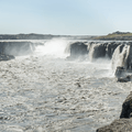 Selfoss pouring over the horseshoe drop.- Dettifoss