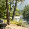 Relaxing on McDonald Creek.- Johns Lake Loop Hike