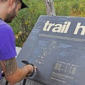 Evaluating the route at the trailhead.- Liberty Lake Backpacking