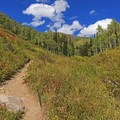 Most of the trail is a steady but gradually sloping trail.- Mill D North to Dog Lake