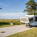 A camper setup in the bayside campground.- Assateague Island Campground