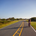 Riding a bike on the road connecting the different camping loops.- Assateague Island Campground