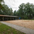 Picnic and playground areas within the campground.- Trap Pond State Park Campground