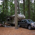 A camper setup.- Trap Pond State Park Campground