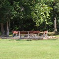 A large fire pit for group bonfires. - Bull Run Campground