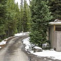 Vault toilets only.- Lewis Lake Campground