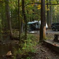 RV camping alongside the creek.- Vogel State Park