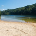 Sandy beach of the swimming area.- Vogel State Park