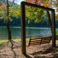 Bench swings line the lakeshore.- Vogel State Park