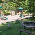 Playground and group fire pit near the campground.- Unicoi State Park Campground