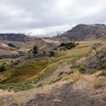 The hike curves around the base of Mount Everts and takes you by Rattlesnake Butte.- Rescue Creek