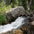 The North Teton Trail parallels the North Fork Teton River for a few miles, offering several small waterfalls.- Table Mountain Loop