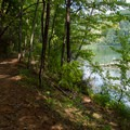 Trail and lake in Unicoi State Park.- Unicoi State Park + Lodge