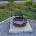 Fire pit and grill.- Shenandoah State Park EW Campground