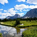 Hiking through the valley near the Red Deer Lakes.- Skoki Loop via Baker Lake and Merlin Meadows