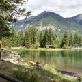 Many campsites have views of the lake and the lodge nearby.- Holland Lake Campground
