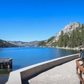 A concrete walkway along lower Echo Lake is a popular spot for fishing and taking in the view.- Echo Lakes Trail
