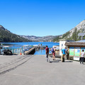 The boat dock and informational sign marking the trail at Echo Chalet.- Echo Lakes Trail
