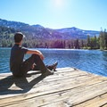 The boat dock at upper Echo Lake marks a destination, and it also serves as the water taxi stop during its seasonal operating schedule.- Echo Lakes Trail