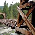 Longmire wooden truss suspension bridge.- Eagle Peak