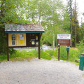 Informational signage and a pay station for the campground.- Wheeler Campground