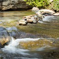 Rock formations at Eastotoe Creek.- Long Shoals Roadside Park
