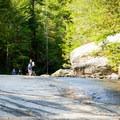 Wading in Eastotoe Creek.- Long Shoals Roadside Park