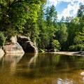 Large rocks flank Eastotoe Creek.- Long Shoals Roadside Park