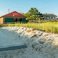 The public restrooms and showers from the beach.- Pine Point Beach