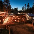 A large central sitting area with ping pong tables, fire pits, bench swings, and quick access to the beer garden.- Basecamp Tahoe South