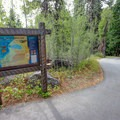 A signboard at the bottom of the descent. Head right here to reach Vikingsholm and the nearest access to Emerald Bay.- Emerald Bay Paddle
