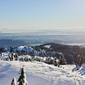 The view from the peak, looking down over Vancouver and across the Georgia Strait to Vancouver Island.- Mount Seymour Snowshoe