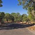 Each site has a picnic table, a fire grate and tent pad.- Natural Bridges Campground