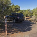 Juniper trees dot the landscape.- Natural Bridges Campground