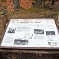 Interpretive sign for the Santiam Wagon Road at the trailhead.- Santiam Wagon Road Trail: McKenzie River Trailhead