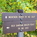 Trailhead sign for Santiam Wagon Road as well as the McKenzie River Trail.- Santiam Wagon Road Trail: McKenzie River Trailhead