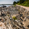 An old sea wall makes up parts of the cliff walk. - Cliff Walk