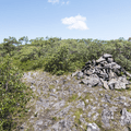 A large cairn marking the summit of South Brace.- Brace Mountain