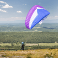 A paraglider about to take flight.- Brace Mountain