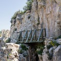 A wooden bridge allows hikers to navigate safely around the cliffs. - Guadalupe Peak Trail