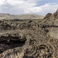 Small lava cave along the route.- North Crater Trail