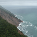 View looking north along the coast.- Cape Smokey Provincial Park
