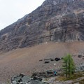 The steep scree walls and sheer cliffs surround Oesa.- Lake Oesa